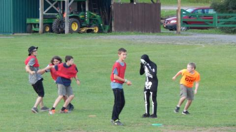 Youth playing in field.