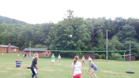 Group of youth playing volleyball.