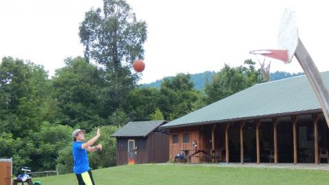 Youth shooting a basket on the b-ball court.