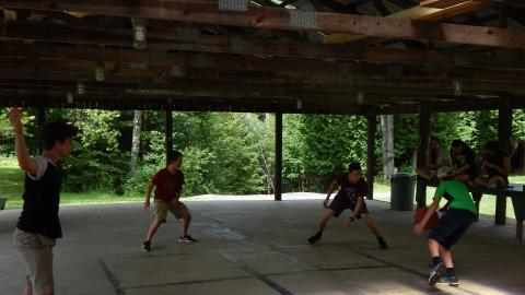 Youth playing a game of 4-square.