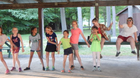 "Cabin group dance ""flossing""."