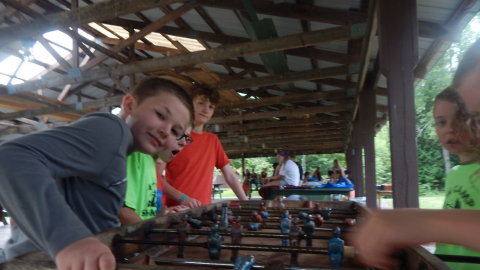 Youth playing Foosball.