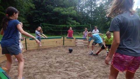 youth playing in the gaga pit.