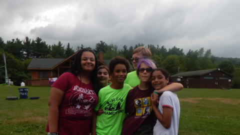 Campers standing close together in a group posing for the camera.