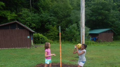 two campers playing tether ball.